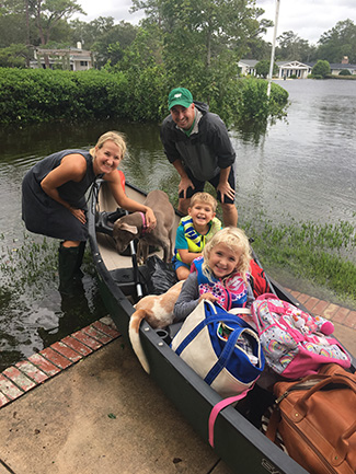 Jacksonville lawyer Charles Jimerson used a canoe to get to higher ground
