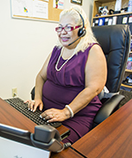 EVELYN PALENCIA now uses a headset to do client intake by phone at the Riviera Beach office of Florida Rural Legal Services.