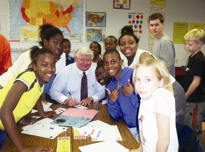 Justice Lewis and students