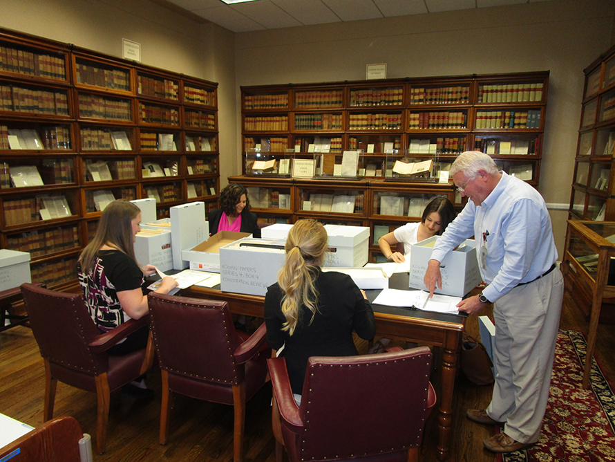 Erik Robinson provides guidance on the procedures for preserving historic documents to FSU law student volunteers