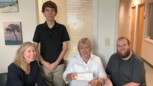 From the left is GLS attorney Nancy Roden, volunteer Daniel, client Margaret, and paralegal James Clegg.