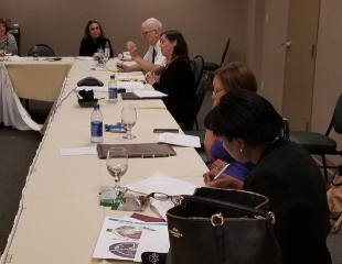 Members of the Senior Lawyers Committee discuss important committee business at The Florida Bar's Fall Meeting.