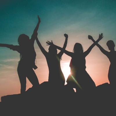 Silhouette of people raising arms