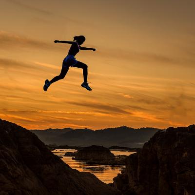 Women jumping across cliffs