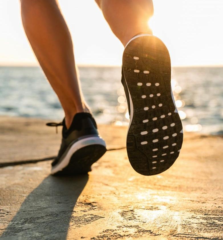 Feet running on beach