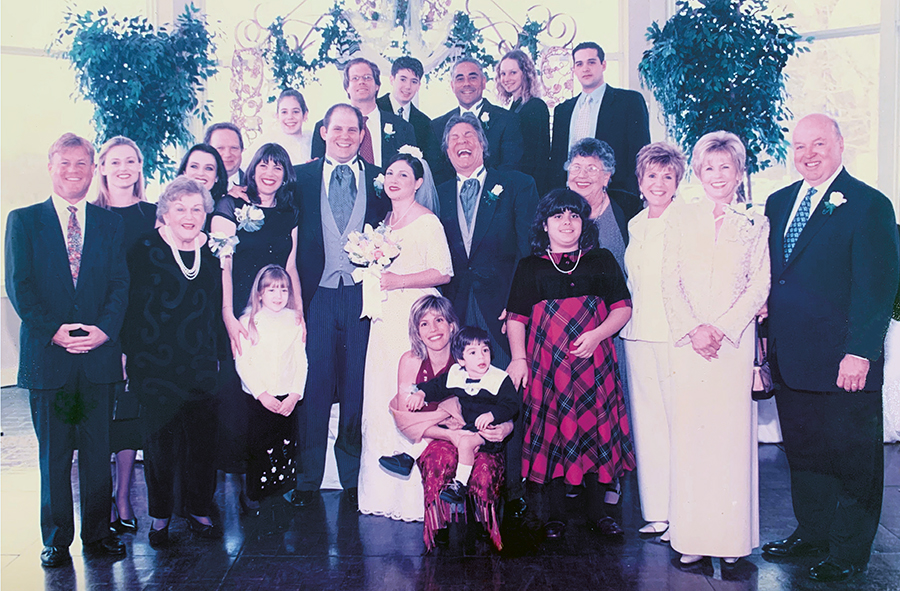 Foster-Morales celebrates with her family at her brother Robert's wedding to his fiancé Stephanie in 2003 in Atlanta, Georgia.