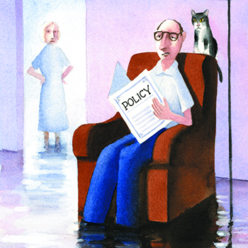 Man reading policy in flooded living room