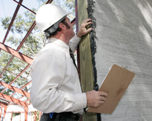 Photo of inspector with stucco