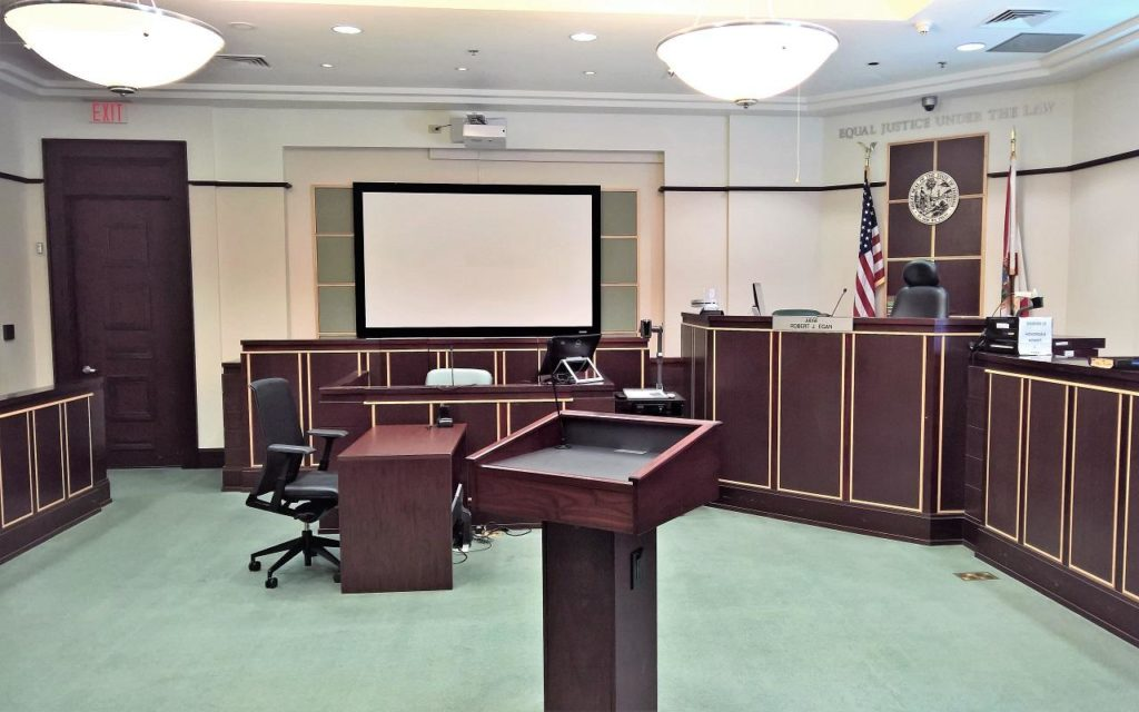 A balance between in-person and virtual court proceedings should be established