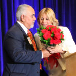 Dori Foster-Morales receives flowers from her husband, Jimmy Morales