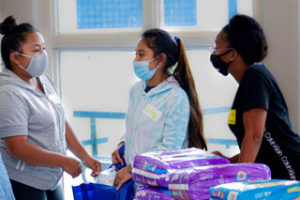 Teen mothers receiving care packages at LAMP
