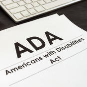 """Square image showing a piece of paper that reads, """"ADA Americans with Disabilities Act"""""""