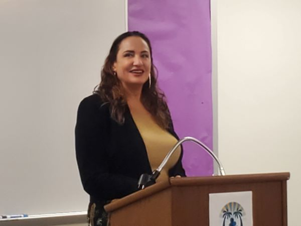 Attorney Ilene Marie Tognini stands at a lectern while giving a presentation about immigration, citizenship and naturalization to Spanish-speaking immigrants at the Palm Springs Public Library on Oct. 7, 2021.
