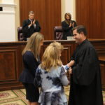 Justice Couriel robed